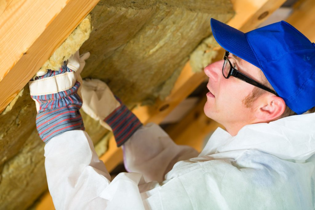 worker setting thermal insulating material Large